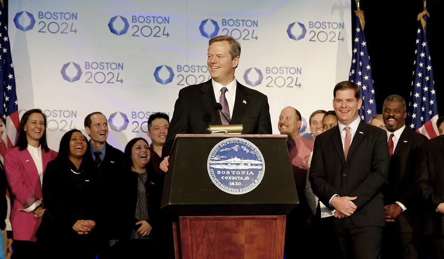 FILE - In this Jan. 9, 2015, file photo,  Massachusetts Gov. Charlie Baker speaks during a news conference in Boston, as Boston Mayor Martin Walsh, second from right, and other looks on, after Boston was picked by the USOC as its bid city for the 2024 Olympic Summer Games. The leaders of the U.S. Olympic Committee are supposed to hear from the governor of Massachusetts on Monday, July 27, 2015. What he tells them could very well dictate the future of Boston's bid for the 2024 Olympics.  (AP Photo/Winslow Townson, File)