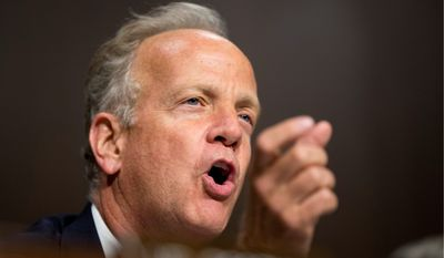 Sen. Jerry Moran, Kansas Republican, has publicly proposed arming all military recruiters after the recent Tennessee shootings. (Associated Press)