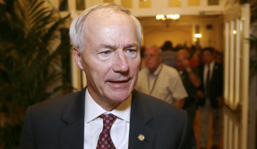 Arkansas Gov. Asa Hutchinson is interviewed after speaking to members of the Arkansas Sheriffs Association in Hot Springs, Ark., Monday, July 27, 2015. Hutchinson says he's asking lawmakers to approve spending $7.4 million from Arkansas' discretionary funds to open 200 more prison beds in an effort to ease overcrowding of state inmates at county jails. (AP Photo/Danny Johnston)