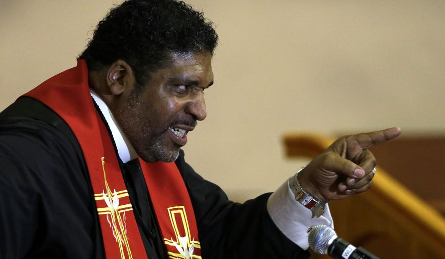 In this Wednesday, June 24, 2015 photo, Rev. William Barber speaks at Pullen Memorial Baptist Church in Raleigh, N.C. His supporters describe Barber, 51, as a leader the likes of which the country hasn't seen since the Rev. Martin Luther King Jr. (AP Photo/Gerry Broome)