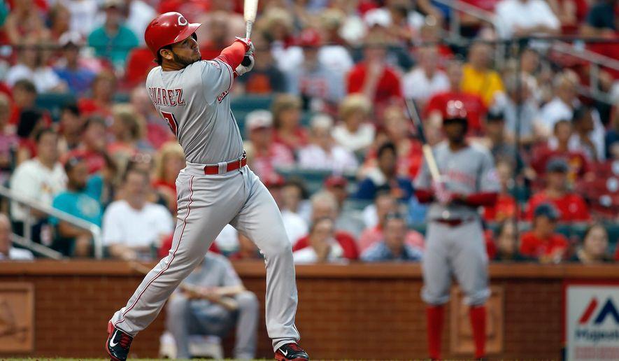 Cincinnati Reds' Eugenio Suarez hits for a single during the second inning of a baseball game against the St. Louis Cardinals, Monday, July 27, 2015, in St. Louis. (AP Photo/Scott Kane)