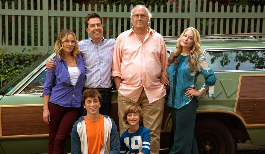 "In this image released by Warner Bros. Entertainment, Christina Applegate, standing from left, Ed Helms, Chevy Chase, Beverly D'Angelo, and Skyler Gisondo, kneeling left, and Steele Stebbins appear in a scene from ""Vacation."" (Hopper Stone/Warner Bros. Entertainment via AP)"