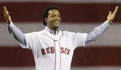 FILE - In this April 4, 2010, file photo, former Boston Red Sox pitcher Pedro Martinez greets the crowd before throwing the ceremonial first pitch before the opening game of the baseball season between the Red Sox and New York Yankees, in Boston. Martinez was elected to the National Baseball Hall of Fame Tuesday, Jan. 6, 2015. (AP Photo/Elise Amendola, File)