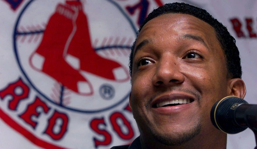FILE - In this Nov. 13, 2000, file photo, Boston Red Sox pitcher Pedro Martinez answers reporter's questions after winning the 2000 American League Cy Young Award at Fenway Park in Boston. All these years of playing in Fenway Park made it tough for pitchers. The Boston Red Sox haven't found one worth of a retired number, until they send Pedro Martinez's No. 45 to the Fenway Park Facade on Tuesday night, July 28, 2015. (AP Photo/Charles Krupa, File)