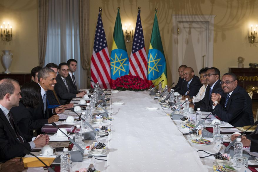 U.S. President Barack Obama, third left,  participates in a bilateral meeting with Ethiopian Prime Minister Hailemariam Desalegn, right, at the National Palace, on Monday, July 27, 2015, in Addis Ababa. Obama is the first sitting U.S. president to visit Ethiopia. (AP Photo/Evan Vucci)