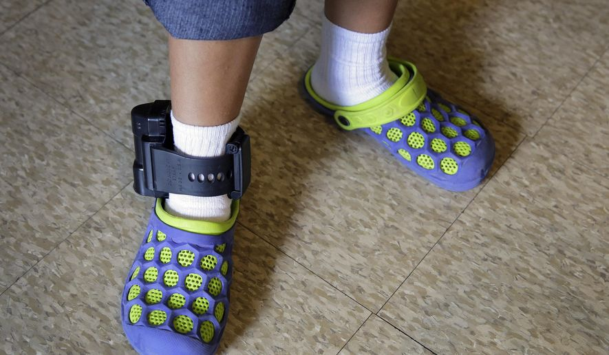 An immigrant from El Salvador that entered the country illegally wears an ankle monitor at a shelter, Monday, July 27, 2015, in San Antonio. Lawyers representing immigrant mothers held in a South Texas detention center say the women have been denied counsel and coerced into accepting ankle-monitoring bracelets as a condition of release, even after judges made clear that paying their bonds would suffice. (AP Photo/Eric Gay)