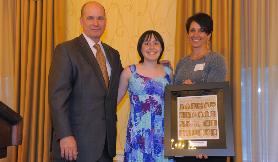 In a Wednesday, May 20, 2015 photo, Nolan Finley, left, Jacqueline Bredenberg, center, of Detroit Country Day, with sponsor Sandy Kuohn pose for a photo,, during the 30th annual Detroit News Outstanding High School Graduate Awards dinner at The Dearborn Inn in Dearborn, Mich. Bredenberg is only the second female to win Gold (hash)1 designation in the 58 years of the Michigan Math Prize Competition for high school students and exceptional middle school students, according to Chris Gardiner, head of the math department at Eastern Michigan University. (Steve Perez/The Detroit News via AP)