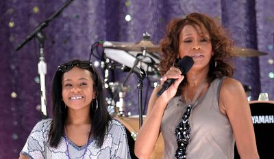 "In this Sept. 1, 2009, file photo, singer Whitney Houston, right, sings with her daughter Bobbi Kristina Brown during a performance on ""Good Morning America"" in Central Park in New York. Brown died Sunday, July 26, 2015, several months after she was found face-down and unresponsive in a bathtub. She was 22 years old. (AP Photo/Evan Agostini, File)"