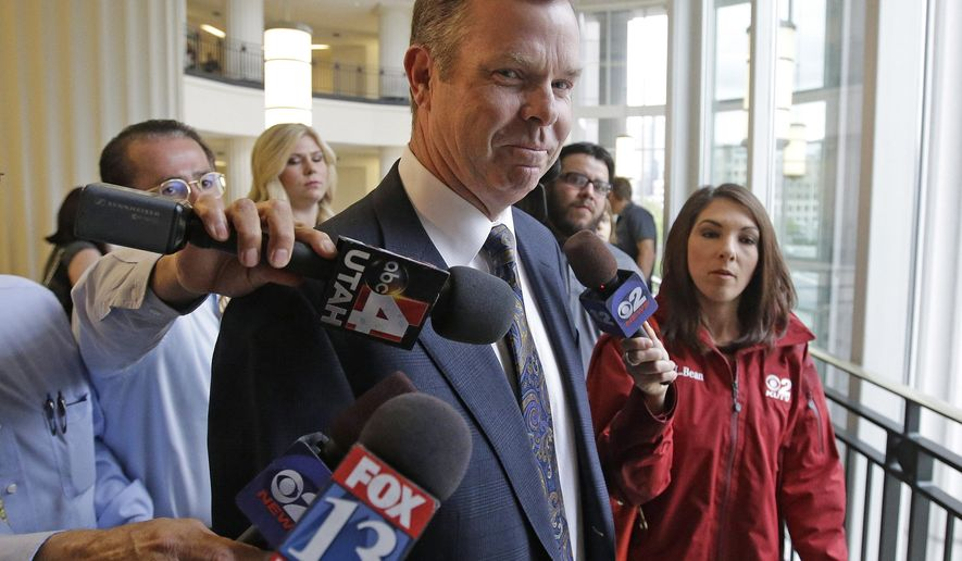 FILE - In this July 30, 2014, file photo, former Utah Attorney General John Swallow arrives at court, in Salt Lake City. Swallow is expected to plead not guilty to 13 charges of bribery and other counts when he appears in a Salt Lake City courtroom Monday, July 27, 2015. Swallow is a Republican who resigned in late 2013 amid a mass of investigations and pay-to-play accusations. (AP Photo/Rick Bowmer, File)