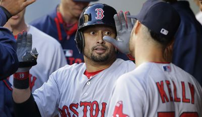 FILE- In this May 14, 2015, file photo, Boston Red Sox's Shane Victorino is greeted in the dugout by starting pitcher Joe Kelly, right, after Victorino hit a solo home run in the fourth inning of a baseball game against the Seattle Mariners in Seattle. The Los Angeles Angels acquired veteran outfielder Victorino from the Red Sox on Monday, July 27, 2015. (AP Photo/Ted S. Warren, File)