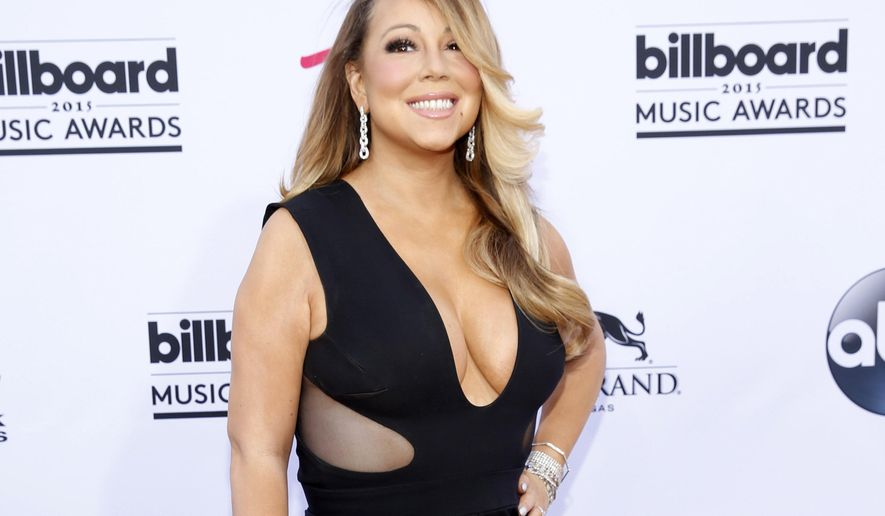 FILE - In this May 17, 2015 file photo, Mariah Carey arrives at the Billboard Music Awards in Las Vegas. The Hollywood Chamber of Commerce announced Monday, July 27, that Carey will receive a star on the Hollywood Walk of Fame on Aug. 5. (Photo by Eric Jamison/Invision/AP, File)