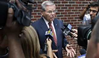 Sen. Robert Menendez, D-N.J., answers a question in Union Township, N.J., Monday, July 27, 2015. The corruption indictment against Menendez is only a few months old, but early court filings pull back the curtain on a legal fight that figures to be bitter, personal and contested at every step. (AP Photo/Mel Evans)