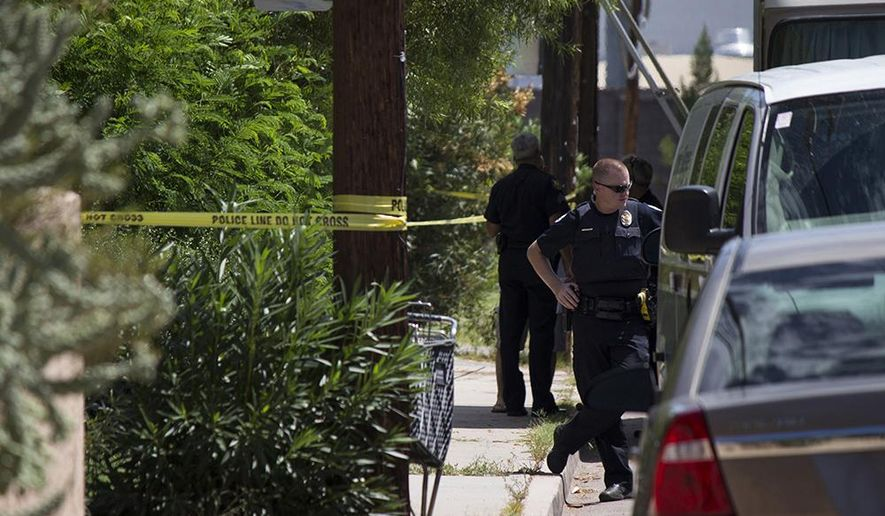 In a Saturday, July 25, 2015 photo, Phoenix police officers work outside a home where they found a woman's decapitated body and two mutilated dogs in Phoenix, Ariz. The body of Trina Heisch was found Saturday in the closet of the apartment she shared with her husband. Investigators say a neighbor went to check on Heisch Saturday and her 43-year-old husband opened the door nude and with several self-inflicted injuries, including a severed left forearm and a missing eye. Police say the husband was being treated for his injuries and will be charged once he is released.  (Mitchell Garrett/The Arizona Republic via AP)  ***MARICOPA COUNTY OUT - NO MAGS- NO SALES - MANDATORY CREDIT***