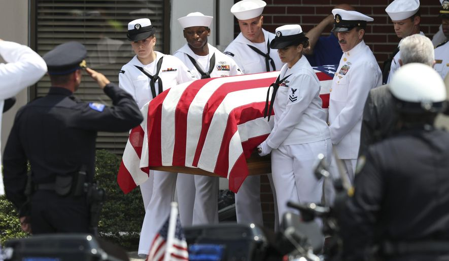Pallbearers carry the casket of Petty Officer 2nd Class Randall Scott Smith out of the First Baptist Church in Fort Oglethorpe, Ga., before transporting him to the Chattanooga National Cemetery on Tuesday, July 28, 2015. Scott was one of five servicemen whose death was the result of a series of shootings at military facilities in Chattanooga, Tennessee, on July 16, 2015. (Dan Henry/Chattanooga Times Free Press via AP) MANDATORY CREDIT: DAN HENRY/CHATTANOOGA TIMES FREE PRESS NOOGA.COM, CLEVELAND DAILY BANNER & DALTON DAILY CITIZEN OUT