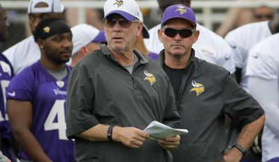 Minnesota Vikings offensive coordinator Norv Turner, left, and head coach Mike Zimmer watch  practice at an NFL football training camp on the campus of Minnesota State University Monday, July 27, 2015, in Mankato, Minn. (AP Photo/Charles Rex Arbogast)