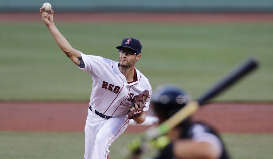 Boston Red Sox starting pitcher Joe Kelly delivers to the Chicago White Sox during the first inning of a baseball game at Fenway Park in Boston, Monday, July 27, 2015. (AP Photo/Charles Krupa)