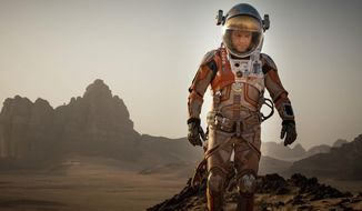 "This photo provided by courtesy of the Toronto International Film Festival and Twentieth Century Fox shows Matt Damon as Mark Watney a scene from the film, ""The Martian,"" directed by Ridley Scott. (Toronto International Film Festival/Twentieth Century Fox via AP)"