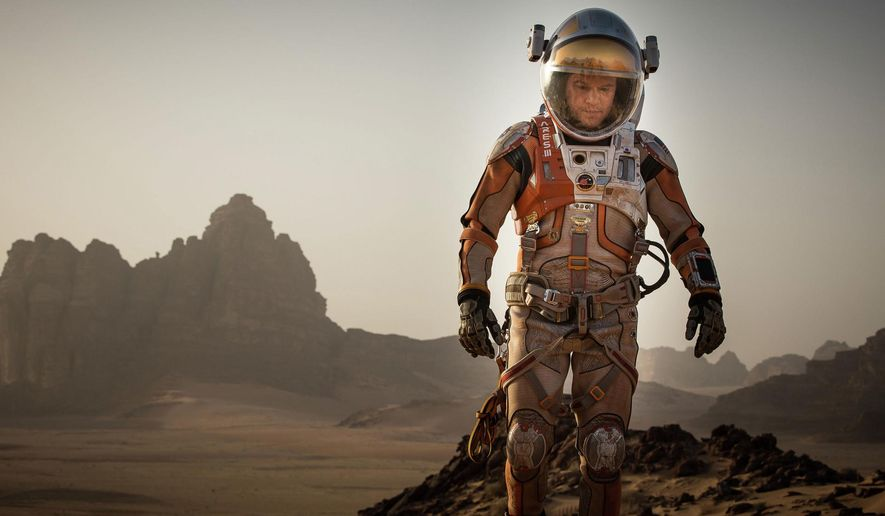 """This photo provided by courtesy of the Toronto International Film Festival and Twentieth Century Fox shows Matt Damon as Mark Watney a scene from the film, """"The Martian,"""" directed by Ridley Scott. (Toronto International Film Festival/Twentieth Century Fox via AP)"""