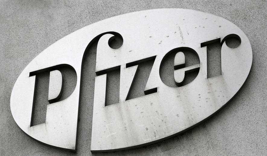 FILE - In this May 4, 2014, file photo, the Pfizer logo is displayed on the exterior of a former Pfizer factory in the Brooklyn borough of New York. The pharmaceutical giant reports quarterly financial results on Tuesday, July 28, 2015.  (AP Photo/Mark Lennihan, File)