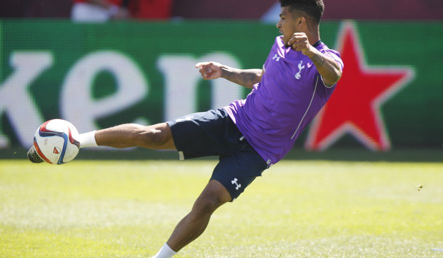 Tottenham Hotspur defender DeAndre Yedlin kicks the ball during a practice for the Major League Soccer All-Star game, Tuesday, July 28, 2015, in Commerce City, Colo. The MLS all-star squad will face the Tottenham Hotspur Wednesday night in Dick's Sporting Goods Park in the 20th annual mid-season classic for the league. (AP Photo/David Zalubowski)