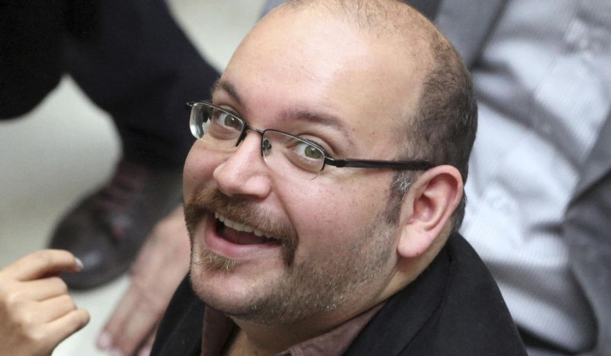 FILE - In this photo April 11, 2013 file photo, Jason Rezaian, an Iranian-American correspondent for the Washington Post, smiles as he attends a presidential campaign of President Hassan Rouhani, in Tehran, Iran. An Iranian news agency is quoting the lawyer of a Rezaian as saying her client should be freed in the wake of the nuclear deal between the Islamic Republic and world powers. (AP Photo/Vahid Salemi, File)