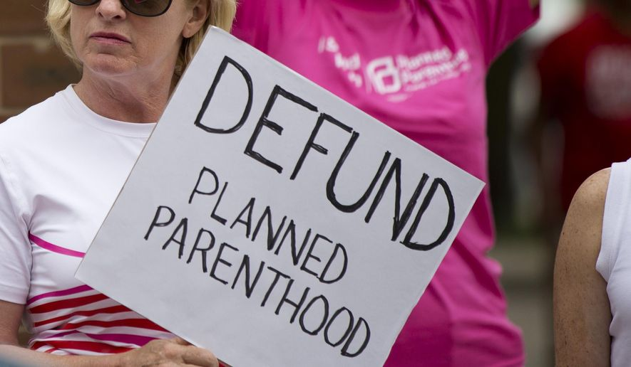 An opponent and supporter of Planned Parenthood demonstrate Tuesday, July 28, 2015, in Philadelphia. Anti-abortion activists are calling for an end to government funding for the nonprofit reproductive services organization. (Associated Press)