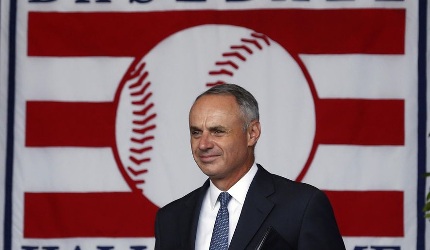 Major League Baseball Commissioner Rob Manfred arrives for the National Baseball Hall of Fame induction ceremony at the Clark Sports Center on Sunday, July 26, 2015, in Cooperstown, N.Y. (AP Photo/Mike Groll)