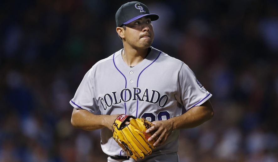 Colorado Rockies starting pitcher Jorge De La Rosa heads to the dugout after being relieved during the fourth inning of a baseball game against the Chicago Cubs in Chicago, Monday, July 27, 2015. (AP Photo/Andrew A. Nelles)