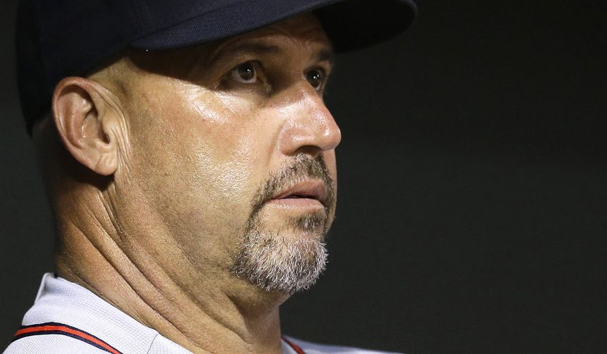 Atlanta Braves manager Fredi Gonzalez watches from the dugout in the seventh inning of an interleague baseball game against the Baltimore Orioles, Tuesday, July 28, 2015, in Baltimore. Baltimore won 7-3. (AP Photo/Patrick Semansky)
