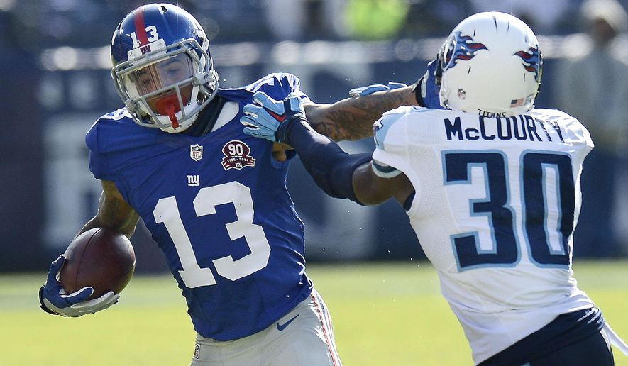 FILE - In this Sunday, Dec. 7, 2014,  file photo, New York Giants wide receiver Odell Beckham Jr. (13) tries to get past Tennessee Titans cornerback Jason McCourty (30) in the first half of an NFL football game in Nashville, Tenn. In just 12 games, Beckham caught 91 passes for 1,305 yeards and 12 touchdowns. The question mark is his hamstring, which cause him to miss the first four games of last season.  (AP Photo/Mark Zaleski, File)