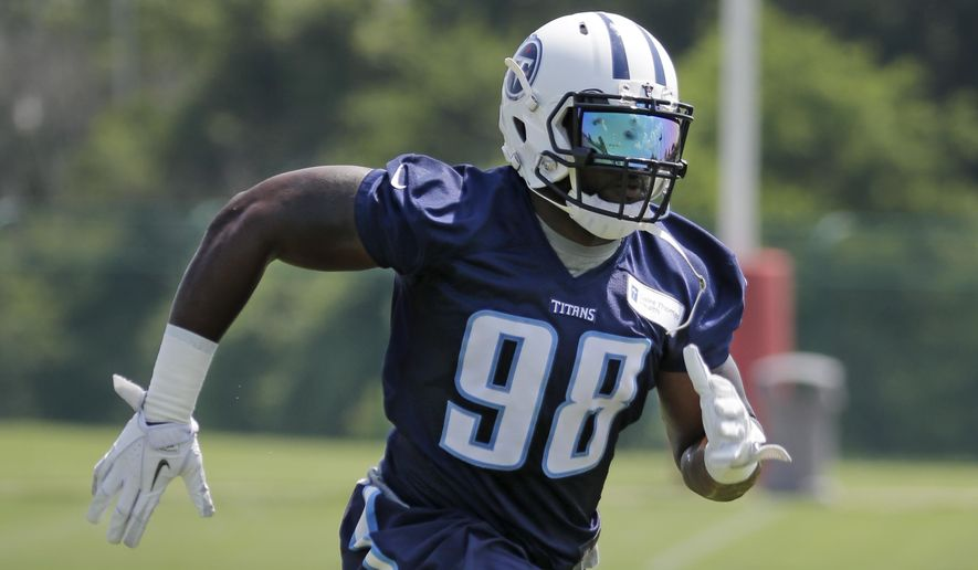 FILE - In this June 10, 2015, filephoto, Tennessee Titans defensive tackle Brian Orakpo practices during an organized team activity at the team's NFL football training facility in Nashville, Tenn. The Titans signed a handful of free agents this offseason, including outside linebacker Orakpo. (AP Photo/Mark Humphrey, File)