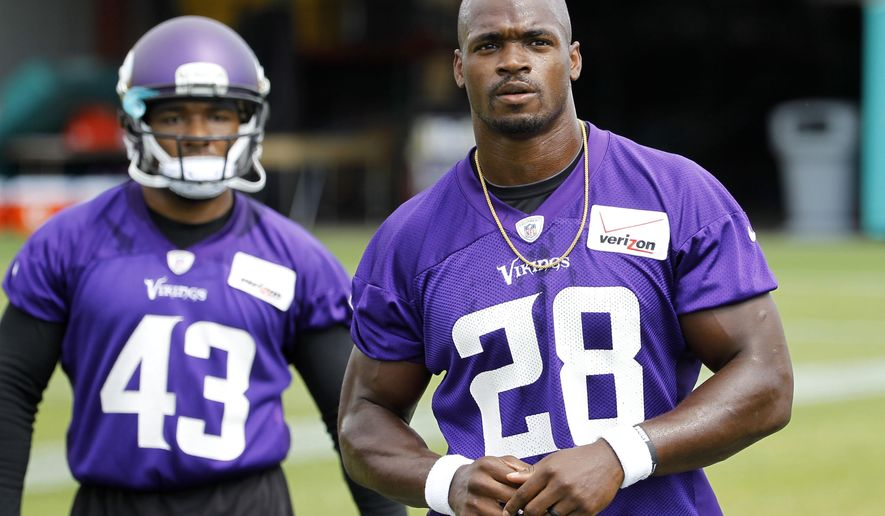 FILE - In this Wednesday, June 17, 2015,  file photo, Minnesota Vikings running back Adrian Peterson (28) walks across the field during NFL football minicamp in Eden Prairie, Minn. The sideshow that overshadowed last season has been dismantled, following Peterson's reinstatement from NFL suspension. (AP Photo/Ann Heisenfelt, File)