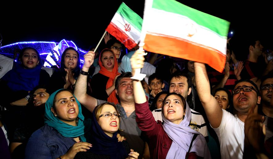 Jubilant Iranians sang and waved Iranian flags during street celebrations in Tehran after a landmark nuclear deal. Many of the country's sidelined reformist politicians and human rights activists are quietly greeting the pact with support. (Associated Press)