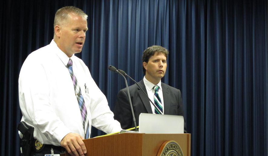 Grand Forks, N.D., Police Chief Brian Nelson, left, and acting U.S. attorney for North Dakota Chris Myers talk on Tuesday, July 28, 2015, about the arrest of a Colombian national as part of synthetic drug ring that has led to several overdoses in the Grand Forks area. The suspect is accused of dealing the drugs during a prison stint in Canada. (AP Photo/Dave Kolpack)