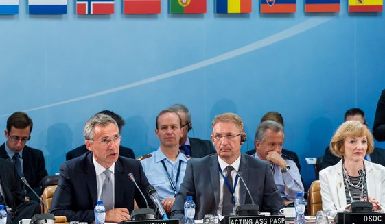 NATO Secretary General Jens Stoltenberg, left, talks during a North Atlantic Council Meeting at NATO headquarters in Brussels on Tuesday July 28, 2015. For just the fifth time in its 66-year history, NATO ambassadors met in emergency session Tuesday to gauge the threat the Islamic State extremist group poses to Turkey, and the debated actions Turkish authorities are taking in response. (AP Photo/Geert Vanden Wijngaert)