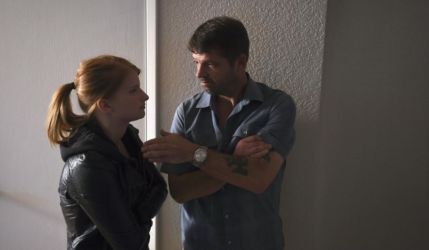 "In a Tuesday, July 21, 2015 photo, actors actors Katie Hemming and Jason Stange discuss a scene during filming for the movie ""Marla Mae"" in Olympia, Wash. Stange was arrested on July 24, 2015, by federal agent for an outstanding probation warrant after being recognized in a photo in a Washington state newspaper that ran a story about the low-budget horror movie. Stange pleaded guilty to an armed bank robbery in 2006 and was given a 117-month prison sentence. A federal probation violation warrant was issued last year after Stange left a halfway house in Spokane. (Tony Overman, The Olympian via AP)"