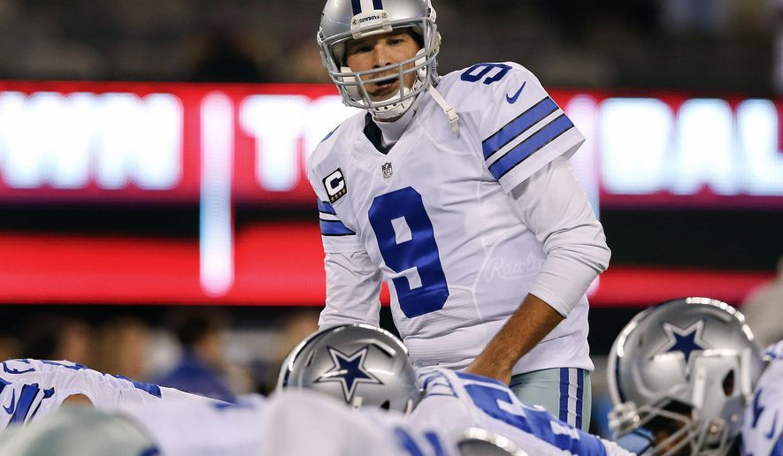 FILE - In this Sunday, Nov. 23, 2014, file photo, Dallas Cowboys quarterback Tony Romo (9) prepares to take a snap during warmups before playing against the New York Giants in an NFL football game in East Rutherford, N.J. Romo heads west with the benefit of offseason practice for the first time since 2012.(AP Photo/Kathy Willens, File)