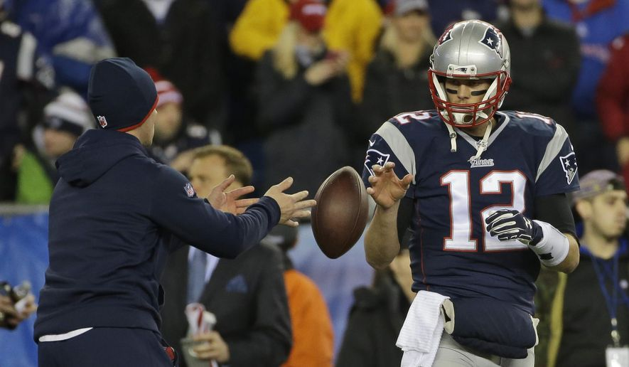 FILE - In this Jan. 18, 2015, file photo, New England Patriots quarterback Tom Brady has a ball tossed to him during warmups before the NFL football AFC Championship game against the Indianapolis Colts in Foxborough, Mass. Brady's four-game suspension for his role in using underinflated footballs during the AFC championship game last season has been upheld by NFL Commissioner Roger Goodell. The league announced the decision Tuesday, July 28, 2015. (AP Photo/Matt Slocum, File)