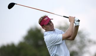 Billy Hurley III watches his tee shot on the 16th hole during the second round of the Arnold Palmer Invitational golf tournament in Orlando, Fla., Friday, March 20, 2015.(AP Photo/Phelan M. Ebenhack)