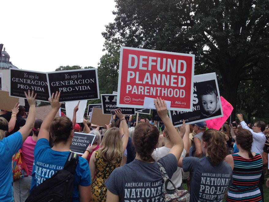 Pro-life activists call for the defunding of Planned Parenthood at a rally at the U.S. Capitol on July 28, 2015. (Cheryl Wetzstein/The Washington Times)