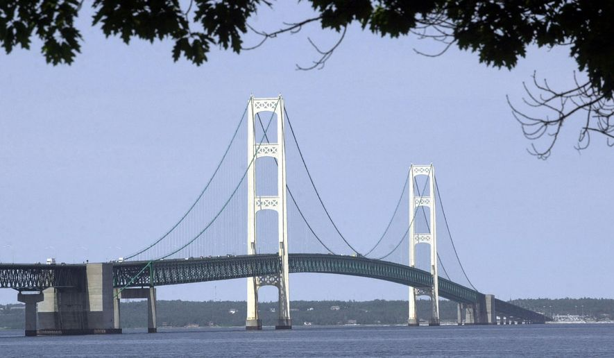 FILE -  In this July 19, 2002 file photo, the Mackinac Bridge is shown from Mackinaw City, Mich. An enviromnental group plans to sue the U.S. Department of Transportation for allowing pipeline owners and operators to transport oil in or under inland waters without approved safety plans as required by federal law. The National Wildlife Federation filed the intent to sue on Tuesday, July 28, 2015, citing several pipeline spills, including the 2010 spill from an Enbridge pipeline into the Kalamazoo River, and concerns that a similar disaster could  occur with Enbridge pipelines in the Straits of Mackinac. (AP Photo/Carlos Osorio)