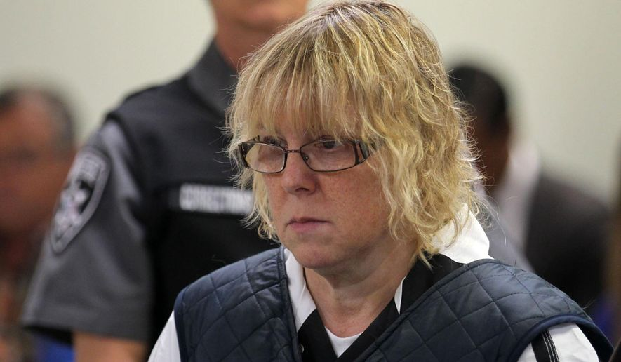 In this June 15, 2015, file photo, Joyce Mitchell appears before Judge Mark Rogers in Plattsburgh, N.Y., City Court for a hearing. (G.N. Miller/New York Post via AP, Pool, File)
