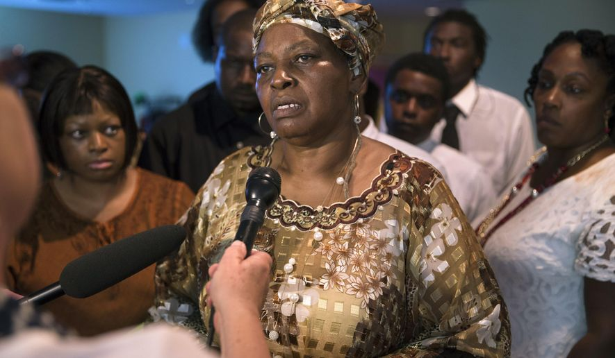 Audrey Dubose, mother of Samuel Dubose, speaks to the media following funeral services at the Church of the Living God in the Avondale neighborhood of Cincinnati, Tuesday, July 28, 2015. Dubose was fatally shot by a University of Cincinnati police officer who stopped him for a missing license plate. (AP Photo/John Minchillo)