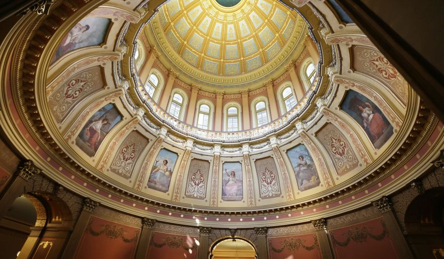 This Tuesday, July 28, 2015 photo shows the interior of the Statehouse dome in Lansing, Mich. Work crews are restoring the exterior of the dome's exterior finishes that wasn't completed during the last major restoration completed in 1992. The dome work is expected to last until mid-October and is part of a $6.4 million project that also includes restoration to parts of the building's exterior. All of the work is expected to wrap up sometime in November. (AP Photo/Carlos Osorio)
