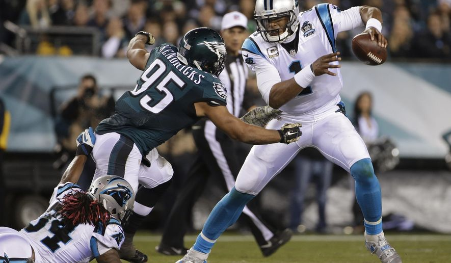 FILE - In this Nov. 10, 2014, file photo, Carolina Panthers' Cam Newton (1) is tackled by Philadelphia Eagles' Mychal Kendricks (95) during the first half of an NFL football game in Philadelphia. The good news for the Panthers is they finally have a healthy Cam Newton heading into tr4aining camp. (AP Photo/Matt Rourke, File)