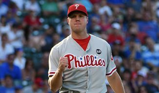 Philadelphia Phillies relief pitcher Jonathan Papelbon reacts after getting the final out against the Chicago Cubs in a baseball game, Friday, July 24, 2015, in Chicago. The Phillies won 5-3 in 10 innings. (AP Photo/David Banks)