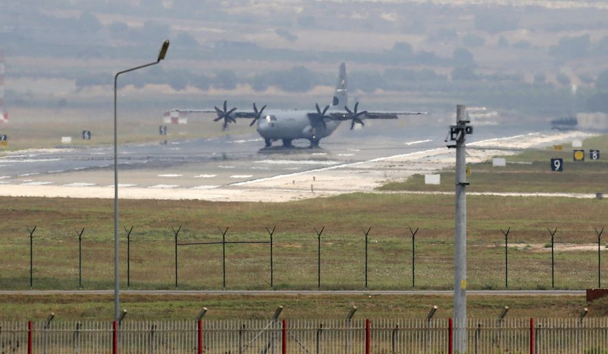 A US Air Force transport plane maneuvers on the runway at Incirlik Air Base, in the outskirts of the city of Adana, southeastern Turkey, Tuesday, July 28, 2015. After months of reluctance, Turkish warplanes started striking militant targets in Syria last week, and also allowed the U.S. to launch its own strikes from Turkey's strategically located Incirlik Air Base. (AP Photo/Emrah Gurel)