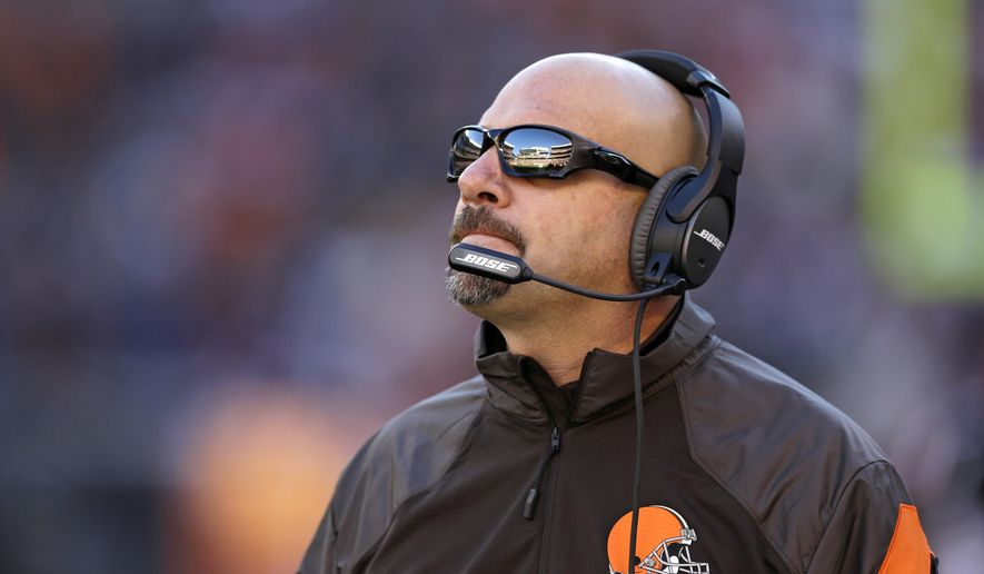 FILE - In this Oct. 26, 2014, file photo, Cleveland Browns head coach Mike Pettine watches an NFL football game against the Oakland Raiders in Cleveland. The Browns were 7-4 in coach Pettine's first season before the bottom fell out with five consecutive losses. (AP Photo/Tony Dejak, File)