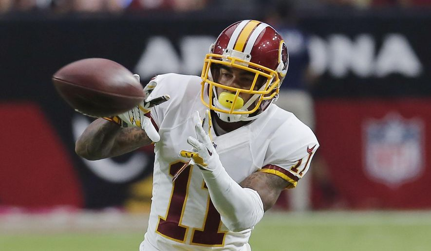 FILE - In this Sunday, Oct. 12, 2014 file photo, Washington Redskins wide receiver DeSean Jackson (11) makes a catch against the Arizona Cardinals during the second half of an NFL football game in Glendale, Ariz. (AP Photo/Rick Scuteri, File)