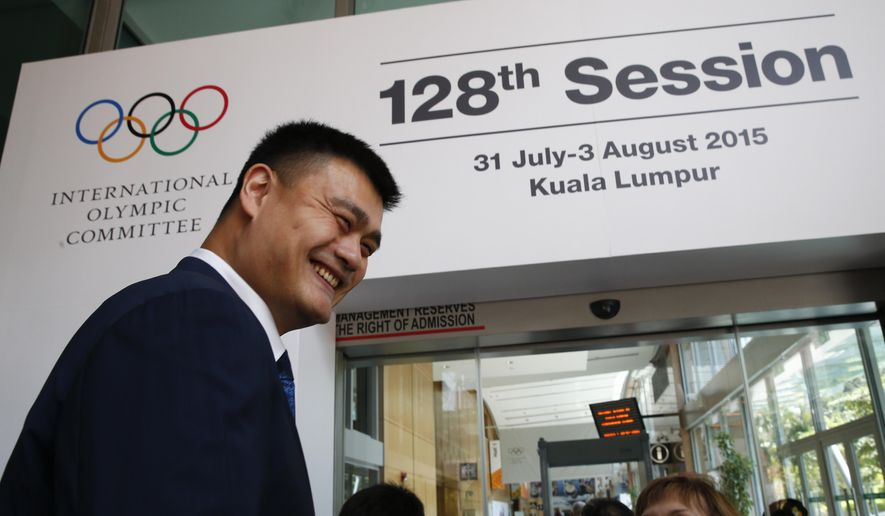 Yao Ming, retired Chinese professional basketball, player arrives at the International Olympic Committee meeting in Kuala Lumpur, Malaysia, Tuesday, July, 28, 2015. Malaysia is hosting the 128th International Olympic Committee executive board meeting where the vote for the host cities of the 2022 Olympic Winter Games and for the 2020 Youth Olympic Winter Games will take place. (AP Photo/Vincent Thian)